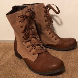 Brown and tan combat boots.